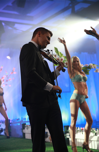 Peter from HOMME string quartet team performs as part of a lingerie fashion parade - Melbourne